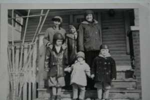 Grandpa C and his siblings. He's the tallest in the back row.