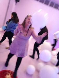 playing in the balloons